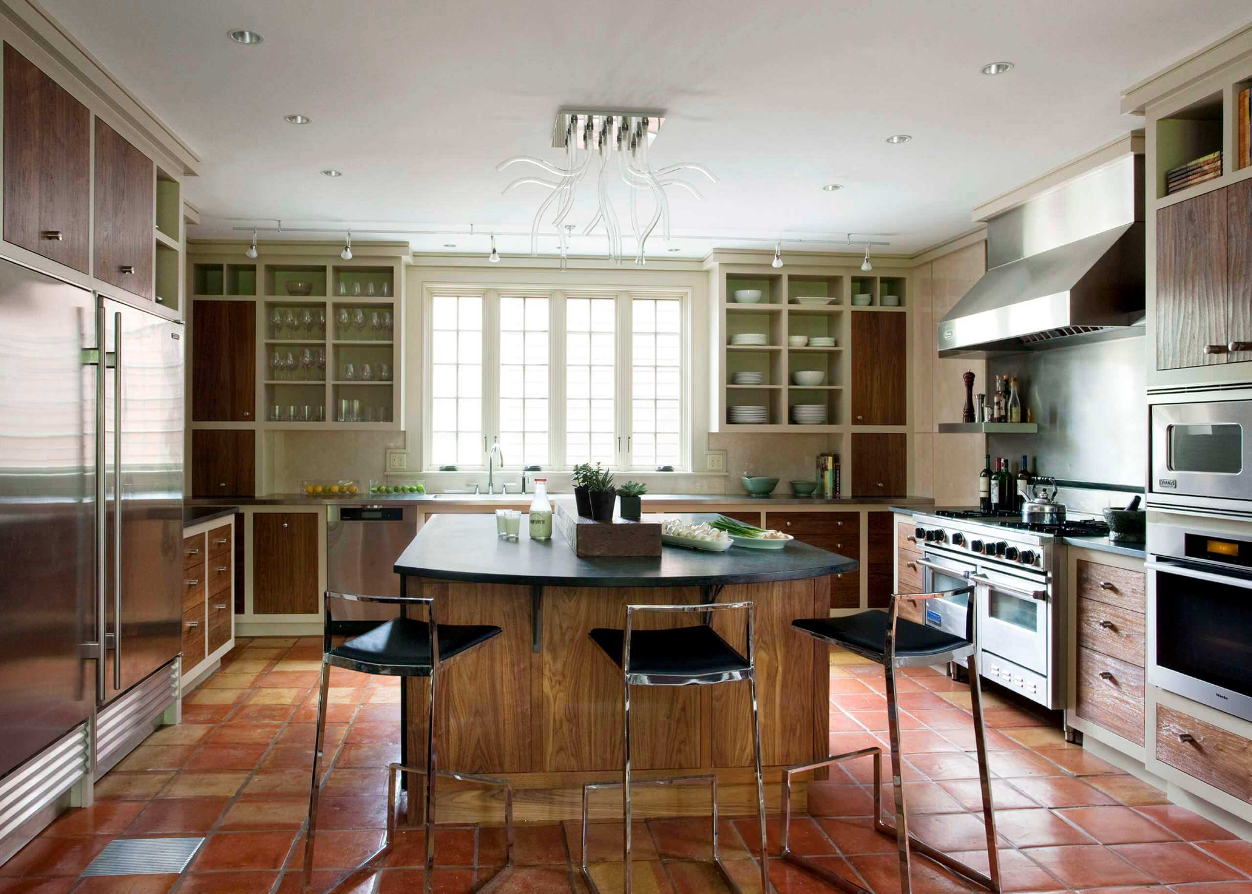 Mountain style u-shaped terra-cotta floor enclosed kitchen photo in Boston with stainless steel appliances, open cabinets, dark wood cabinets and soapstone countertops