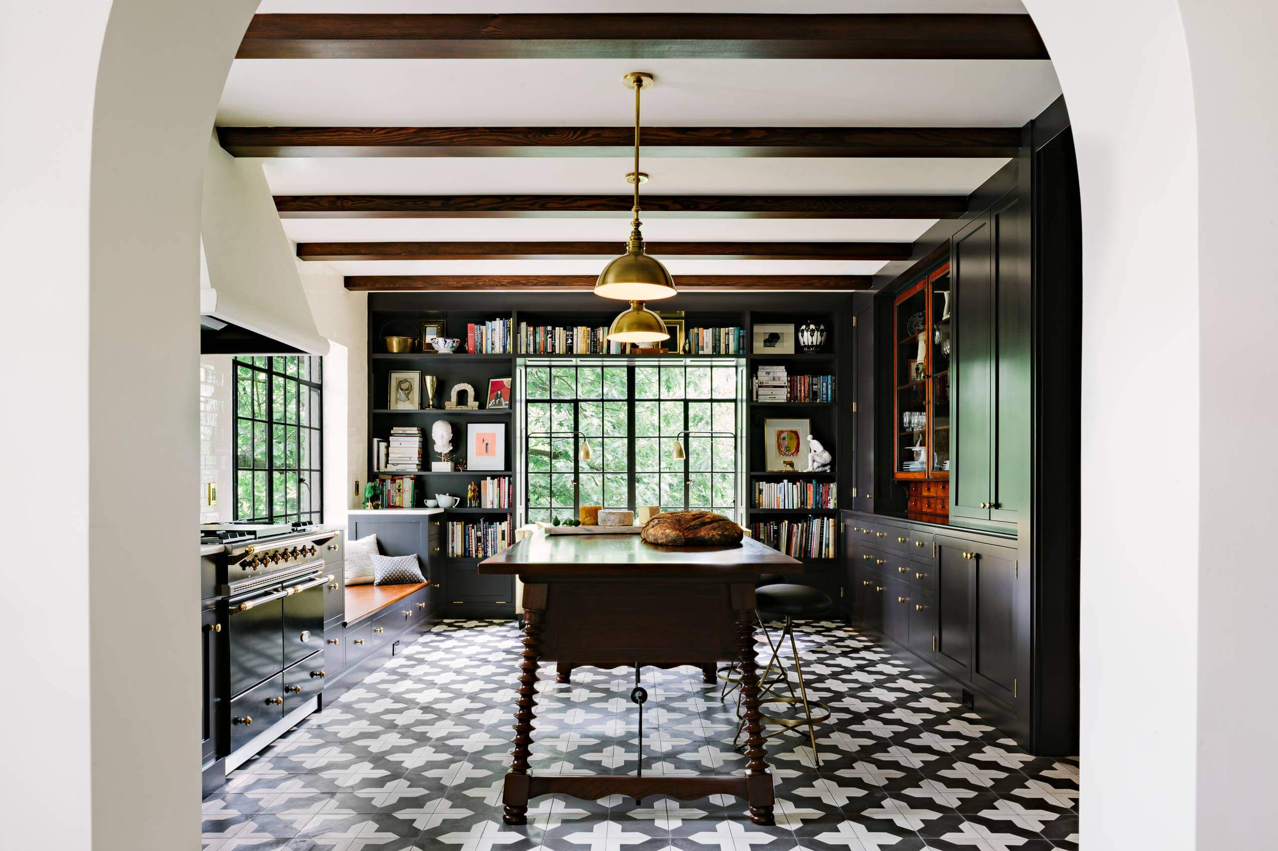Kitchen - mediterranean multicolored floor kitchen idea in Portland with black cabinets and an island