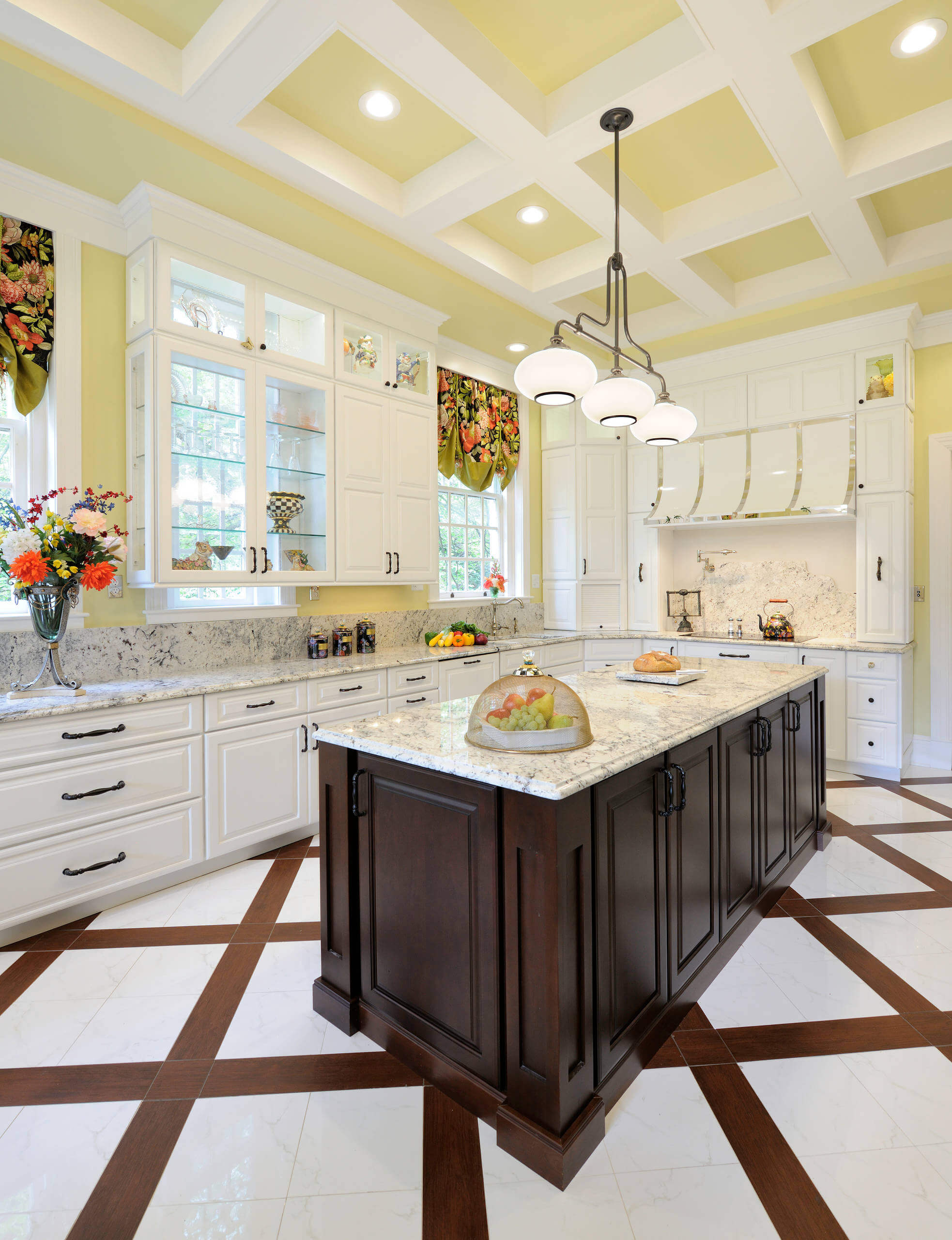 Example of a huge transitional u-shaped porcelain floor enclosed kitchen design in St Louis with white cabinets, granite countertops, an island, raised-panel cabinets, stone slab backsplash and paneled appliances