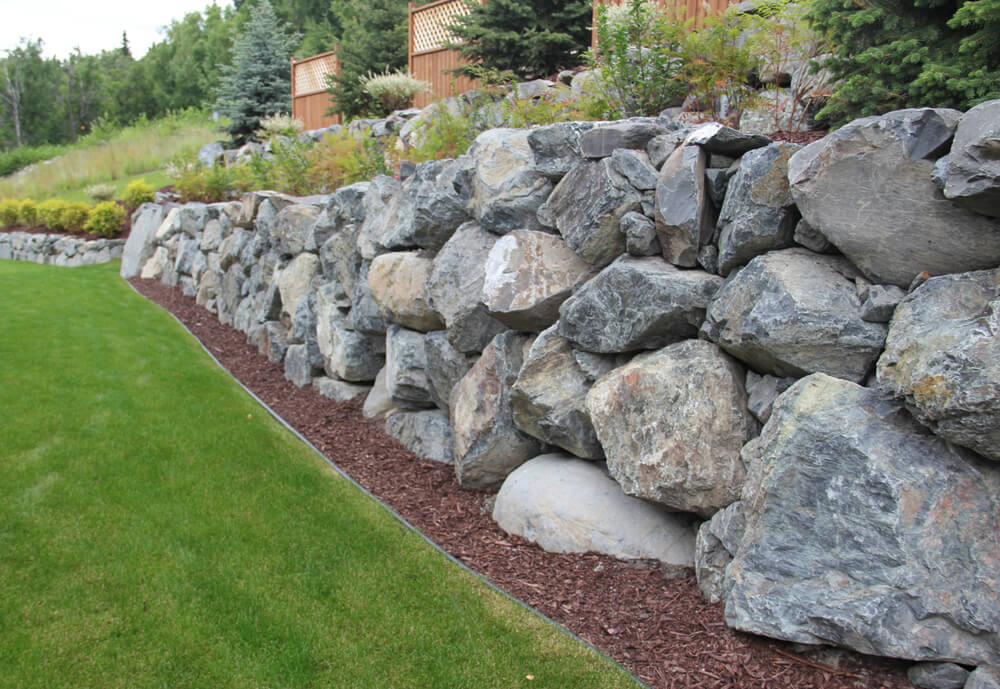 Boulders for retaining wall