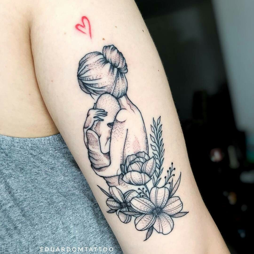 Tattoo of mother hugging her baby