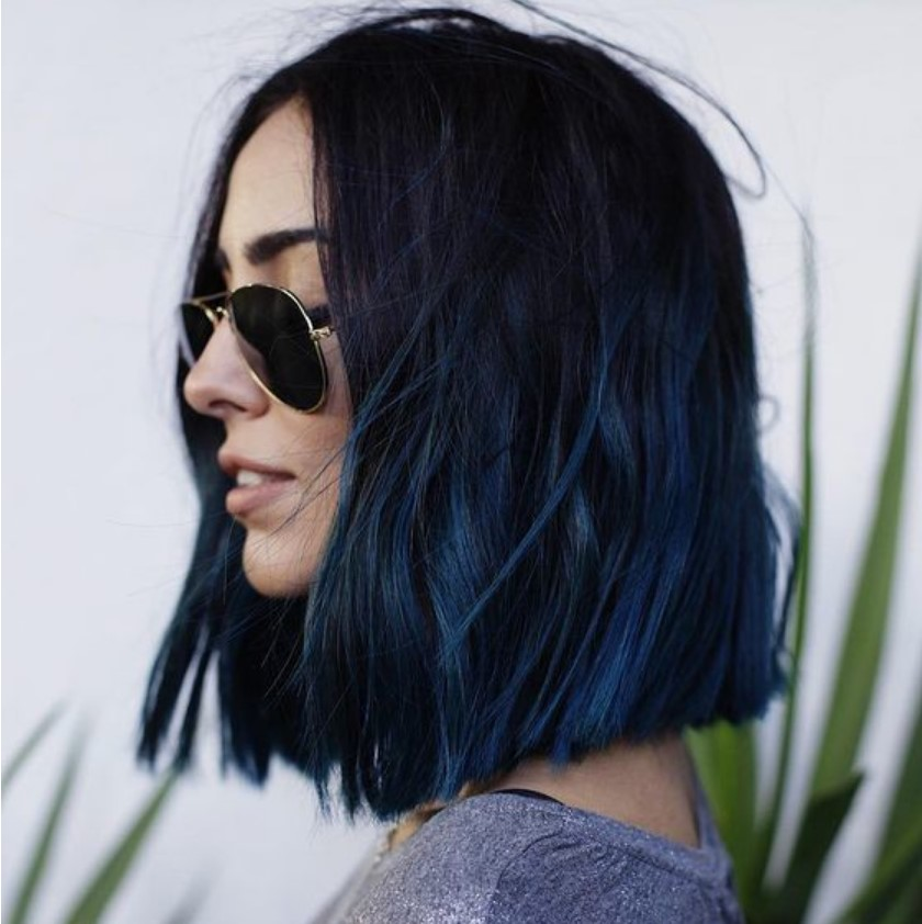 Girl with midi hair in blue tone, posing in profile