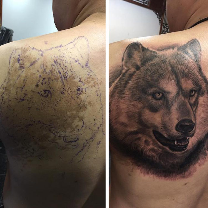 Boy with a wolf tattoo on his back