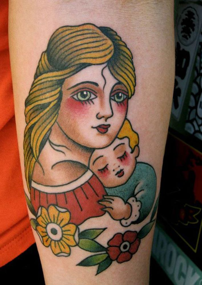 Old school tattoo of mom carrying her son