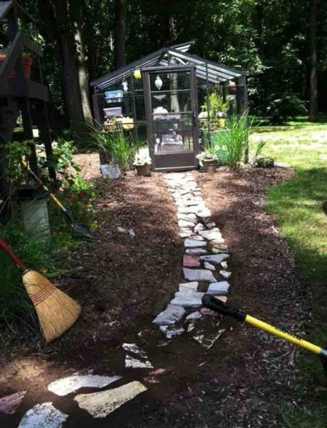 Stones Being Laid in Cottage Garden Pathway