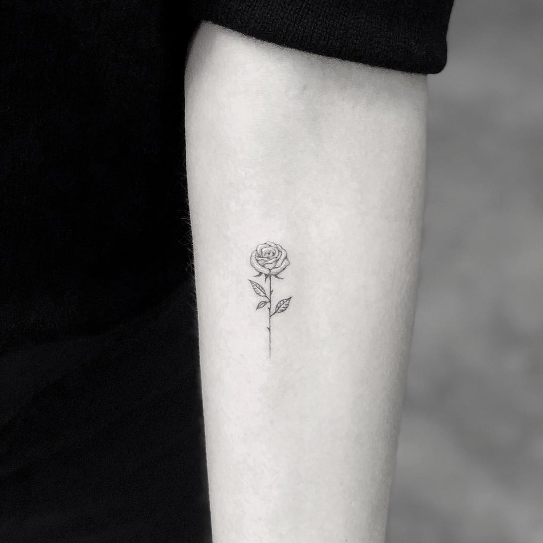Girl with a tattoo of a rose