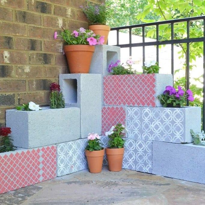 Cinder block planter with flower pots