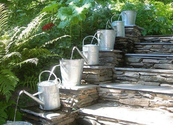 Watering can feature