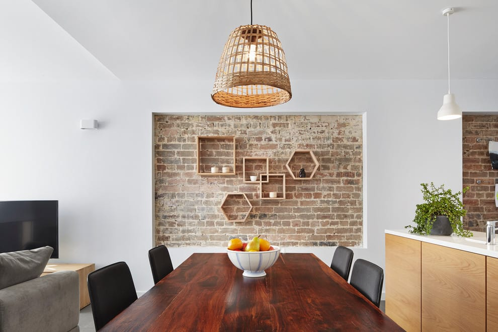 Timber wall shelves combined with exposed bricks