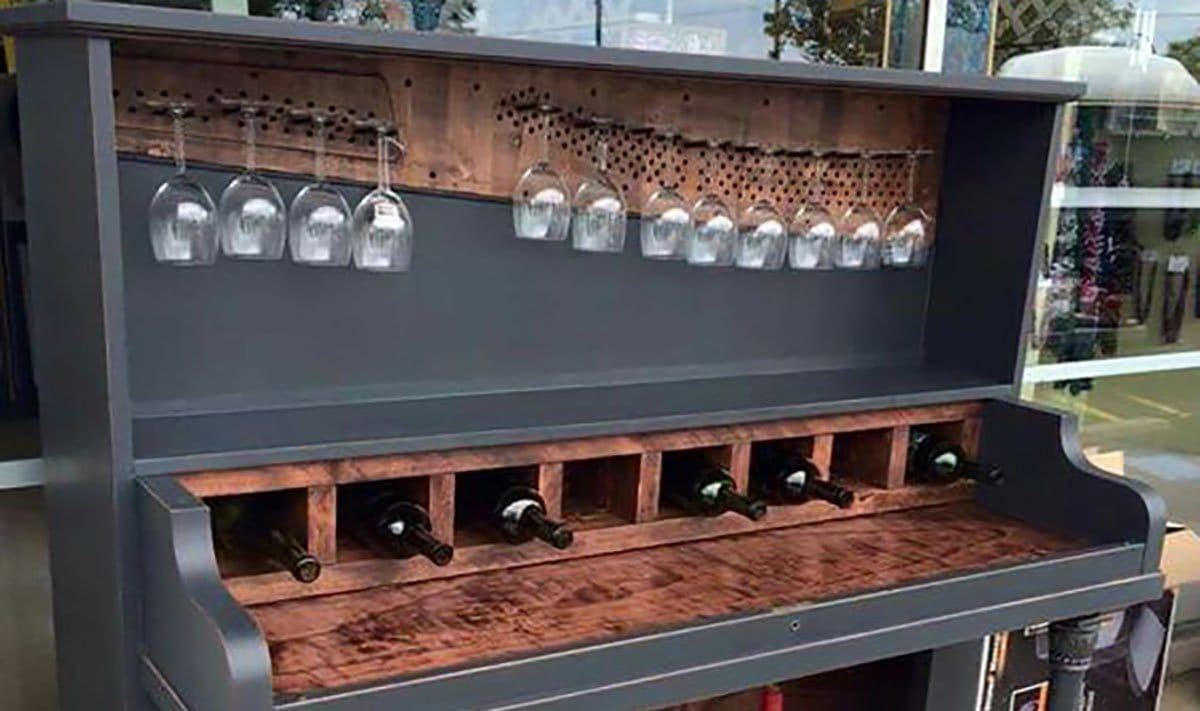 Repurposed Old Piano into Glass Hanger